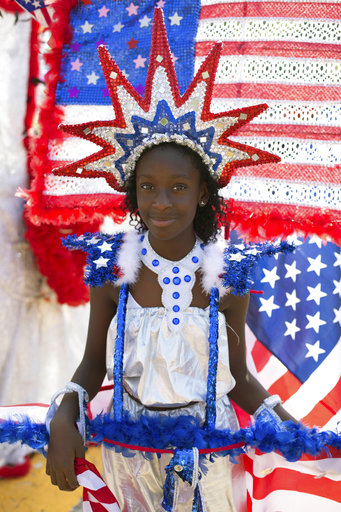 <div class='meta'><div class='origin-logo' data-origin='AP'></div><span class='caption-text' data-credit='Kevin Hagen'>Zaria Corbin, 10, participates in costume at the West Indian Day Parade on Monday, Sept. 4, 2017, in the Brooklyn borough of New York.</span></div>