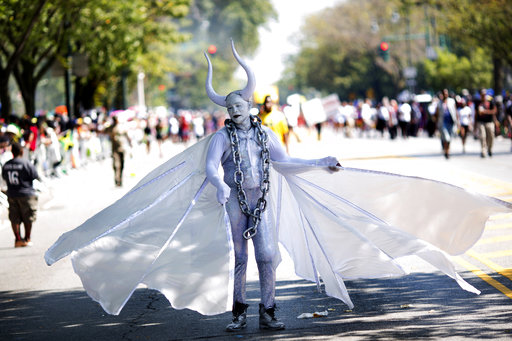 <div class='meta'><div class='origin-logo' data-origin='AP'></div><span class='caption-text' data-credit='Kevin Hagen'>A member of the J'ouvert masquerade group Pagwah performs during the West Indian Day Parade on Monday, Sept. 4, 2017, in the Brooklyn borough of New York.</span></div>