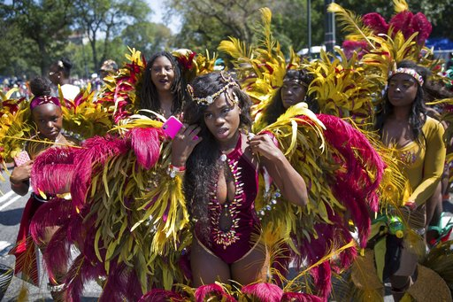 <div class='meta'><div class='origin-logo' data-origin='AP'></div><span class='caption-text' data-credit='Kevin Hagen'>Costumed dancers perform during the West Indian Day Parade on Monday, Sept. 4, 2017, in the Brooklyn borough of New York. T</span></div>
