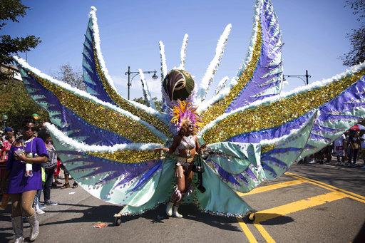 <div class='meta'><div class='origin-logo' data-origin='AP'></div><span class='caption-text' data-credit='Kevin Hagen'>West Indian Day Parade on Monday, Sept. 4, 2017, in the Brooklyn borough of New York.</span></div>