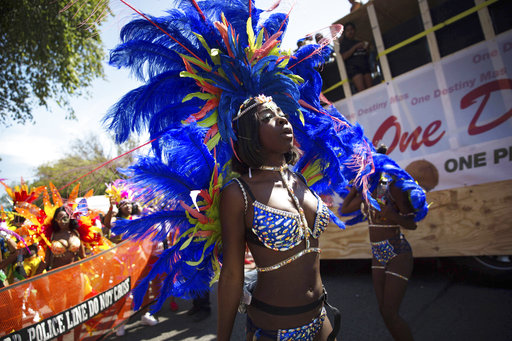 <div class='meta'><div class='origin-logo' data-origin='AP'></div><span class='caption-text' data-credit='Kevin Hagen'>Costumed dancers perform during the West Indian Day Parade on Monday, Sept. 4, 2017, in the Brooklyn borough of New York.</span></div>