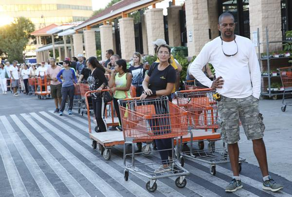 """<div class=""""meta image-caption""""><div class=""""origin-logo origin-image ap""""><span>AP</span></div><span class=""""caption-text"""">Eduardo Soriano of Miami, waits in a line since dawn to purchase plywood sheets at a Home Depot store in North Miami, Fla., Wednesday. (Marta Lavandier)</span></div>"""