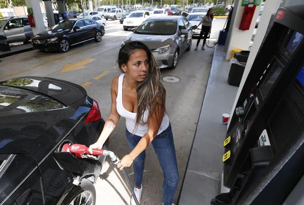 """<div class=""""meta image-caption""""><div class=""""origin-logo origin-image ap""""><span>AP</span></div><span class=""""caption-text"""">Carli Andrade of Miami, pumps gas at a Costco gas station, Wednesday, Sept. 6, 2017, in North Miami, Fla. (Wilfredo Lee)</span></div>"""