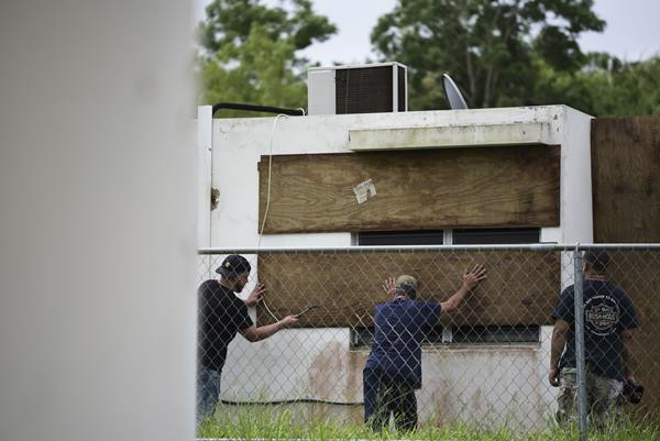 "<div class=""meta image-caption""><div class=""origin-logo origin-image ap""><span>AP</span></div><span class=""caption-text"">Residents of Las Lomas community board up windows in preparation for Hurricane Irma, in Ceiba, Puerto Rico, Wednesday, Sept. 6, 2017. (Carlos Giusti)</span></div>"