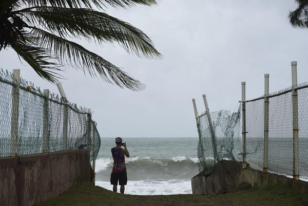 """<div class=""""meta image-caption""""><div class=""""origin-logo origin-image ap""""><span>AP</span></div><span class=""""caption-text"""">A man photographs the ocean before the arrival of Hurricane Irma, in luquillo, Puerto Rico, Wednesday, Sept. 6, 2017. (Carlos Giusti)</span></div>"""