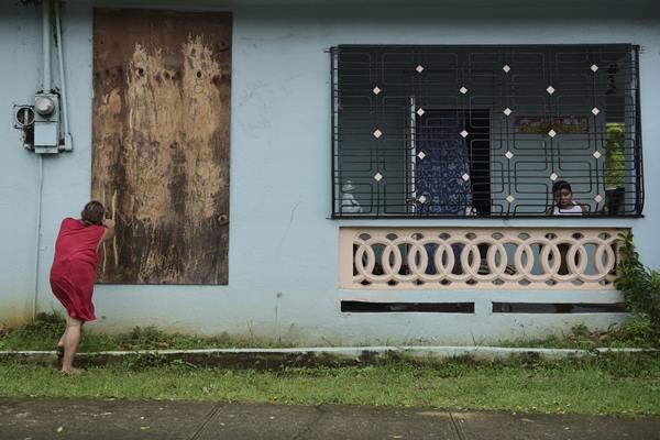 "<div class=""meta image-caption""><div class=""origin-logo origin-image ap""><span>AP</span></div><span class=""caption-text"">A woman boards up a window in preparation for Hurricane Irma, in Ceiba, Puerto Rico, Wednesday, Sept. 6, 2017. (Carlos Giusti)</span></div>"