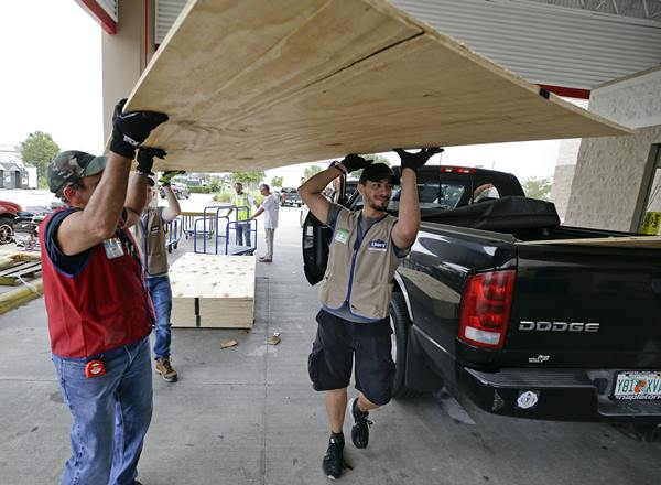 """<div class=""""meta image-caption""""><div class=""""origin-logo origin-image ap""""><span>AP</span></div><span class=""""caption-text"""">Employees of a building supply store load sheets of plywood for a customer in the back of a truck during preparation for Hurricane Irma, Wednesday, Sept. 6, 2017, in Orlando, Fla. (John Raoux)</span></div>"""