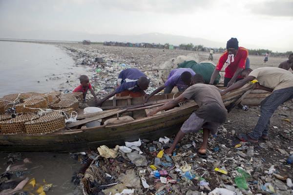 "<div class=""meta image-caption""><div class=""origin-logo origin-image ap""><span>AP</span></div><span class=""caption-text"">Fishermen remove their wooden boat from the sea as a precaution against Hurricane Irma, in Port-au-Prince, Haiti, Wednesday, Sept. 6, 2017. (Dieu Nalio Chery)</span></div>"