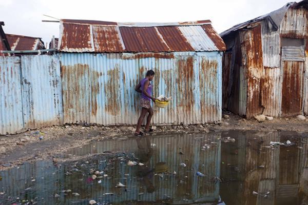 "<div class=""meta image-caption""><div class=""origin-logo origin-image ap""><span>AP</span></div><span class=""caption-text"">A woman skirts a puddle as she walks home in Port-au-Prince, Haiti, Wednesday, Sept. 6, 2017. (Dieu Nalio Chery)</span></div>"