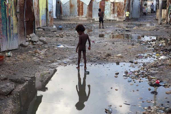 """<div class=""""meta image-caption""""><div class=""""origin-logo origin-image ap""""><span>AP</span></div><span class=""""caption-text"""">A child plays in a puddle in Port-au-Prince, Haiti, Wednesday, Sept. 6, 2017. (Dieu Nalio Chery)</span></div>"""