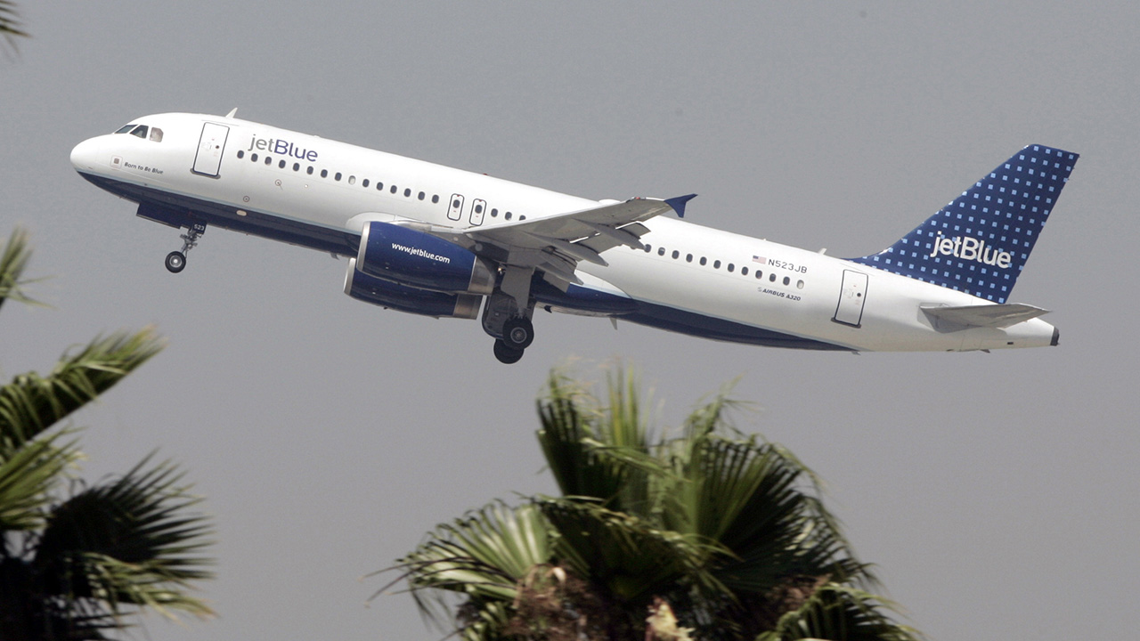 A JetBlue Airbus A320 climbs out from Bob Hope Airport in Burbank, Calif