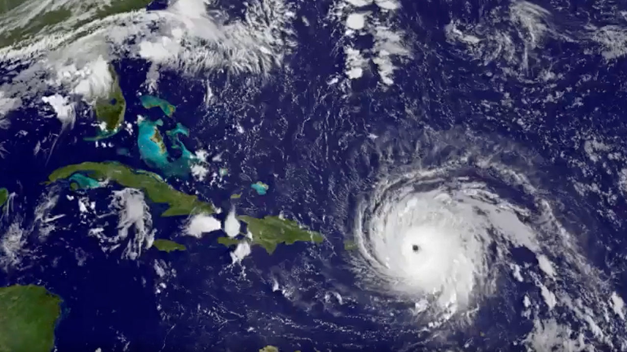 A NASA/NOAA satellite image shows Hurricane Irma moving through the Atlantic Ocean and hitting islands in the Caribbean.