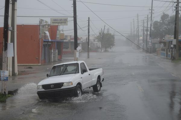 <div class='meta'><div class='origin-logo' data-origin='AP'></div><span class='caption-text' data-credit='Carlos Giusti'>A man drives through rain and strong winds during the passage of hurricane Irma, in Fajardo, Puerto Rico, Wednesday, Sept. 6, 2017.</span></div>