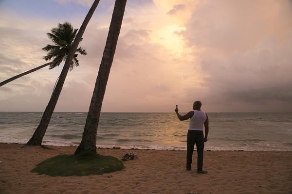 <div class='meta'><div class='origin-logo' data-origin='AP'></div><span class='caption-text' data-credit='Tatiana Fernandez'>A man records the sunset on the evening before the arrival of Hurricane Irma in Las Terrenas, Dominican Republic, Wednesday, Sept. 6.</span></div>