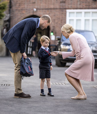 <div class='meta'><div class='origin-logo' data-origin='Creative Content'></div><span class='caption-text' data-credit='Richard Pohle/Pool Photo via AP'>Britain's Prince William accompanies Prince George as he is greeted by Helen Haslem - the head of the lower school as he arrives for his first day of school.</span></div>