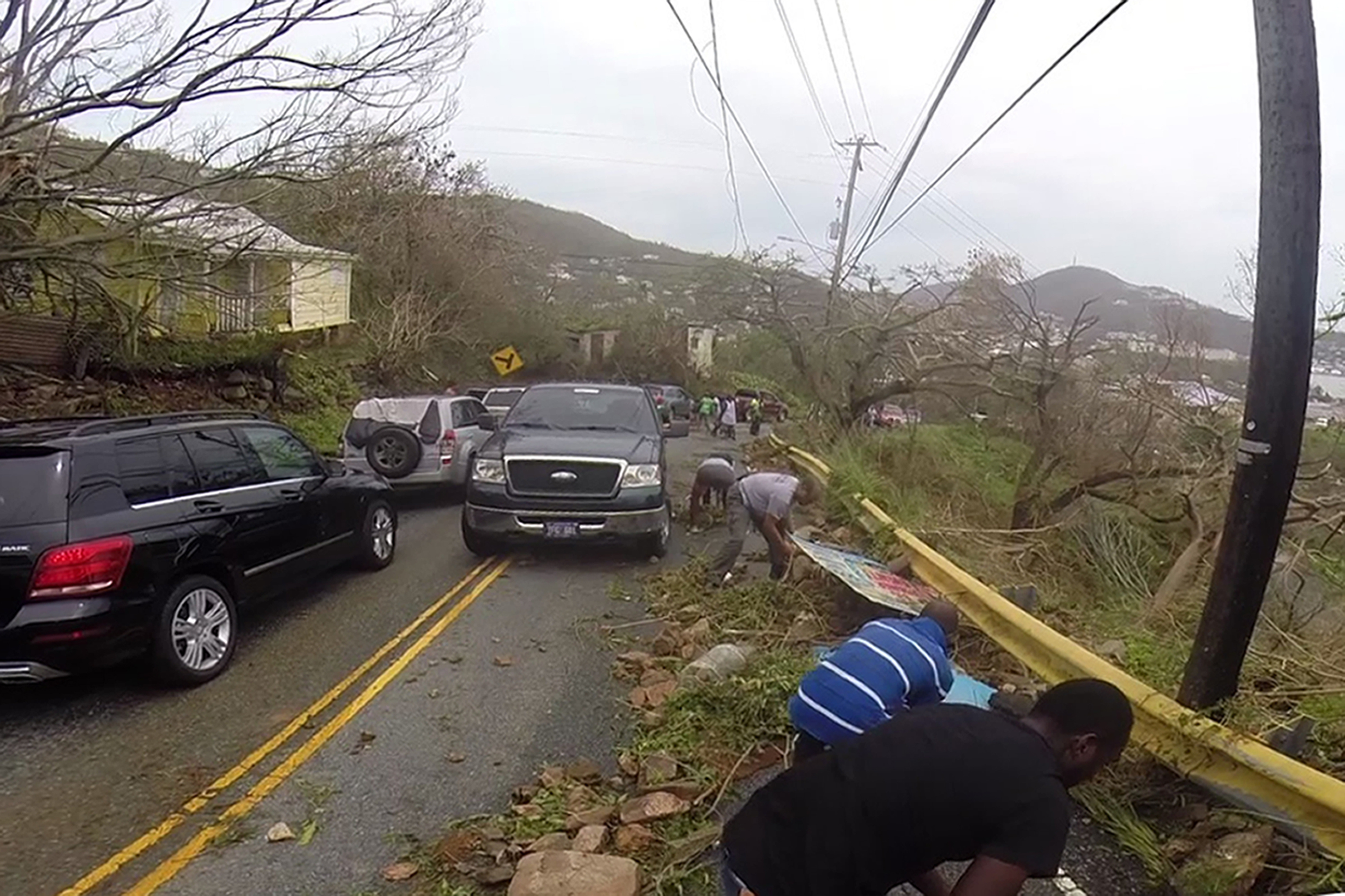 "<div class=""meta image-caption""><div class=""origin-logo origin-image none""><span>none</span></div><span class=""caption-text"">In this image made from video, motorists remove debris caused by Hurricane Irma from the road in St. Thomas, U.S. Virgin Islands, Thursday, Sept. 7, 2017. (Ian Brown/AP Photo)</span></div>"