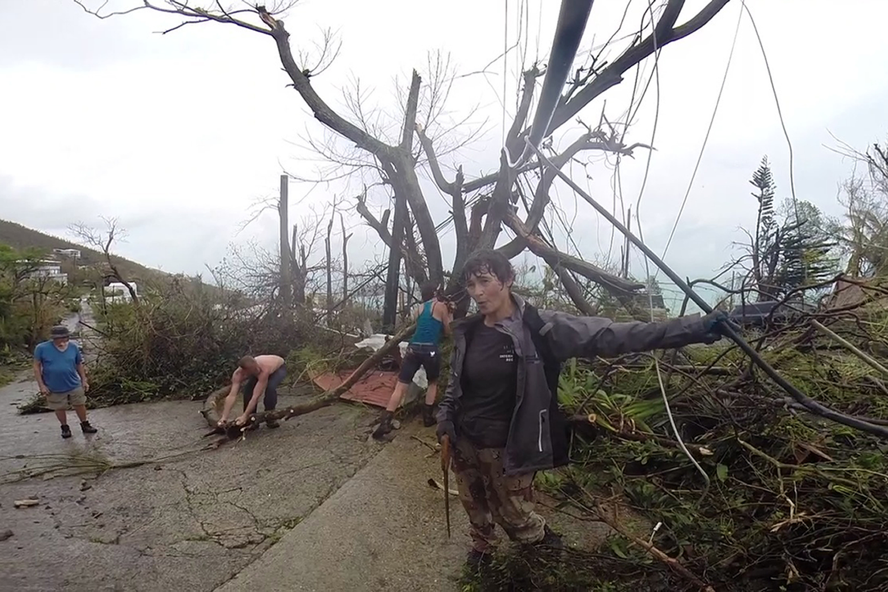 """<div class=""""meta image-caption""""><div class=""""origin-logo origin-image none""""><span>none</span></div><span class=""""caption-text"""">In this image made from video, neighbors clear debris from the road in St. Thomas, U.S. Virgin Islands, Thursday, Sept. 7, 2017. (Ian Brown/AP Photo)</span></div>"""