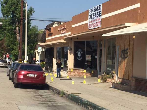 Evidence markers dot the sidewalk along Penn Street in Whittier on Friday, Sept. 8, 2017.