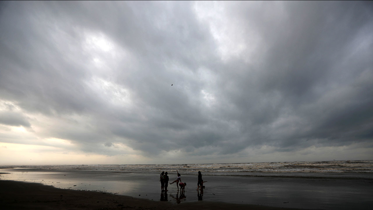 People walk on the beach before the arrival of Hurricane Katia, in Tecolutla, Veracruz state, Mexico, Thursday,