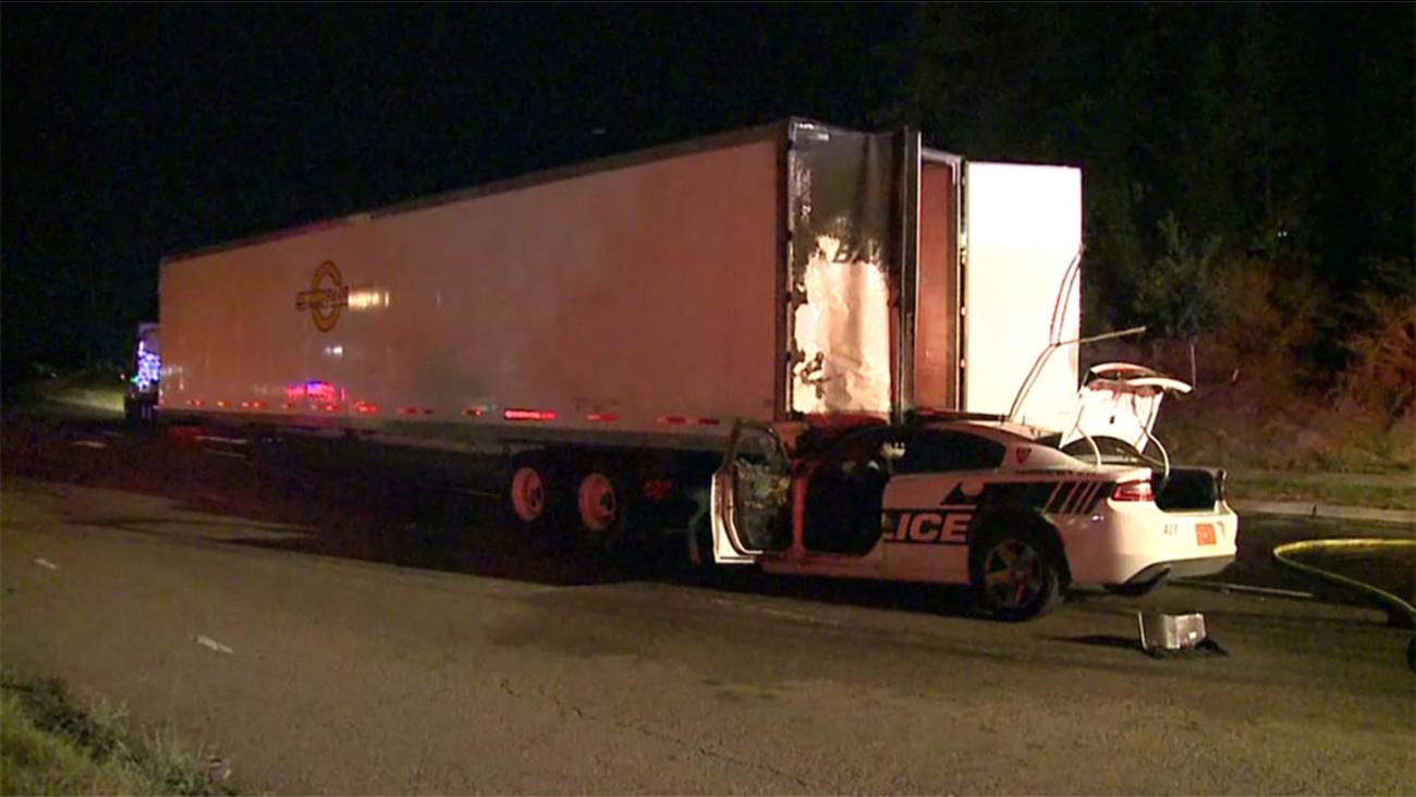 A Durham Police cruiser crashed into an 18-wheeler.