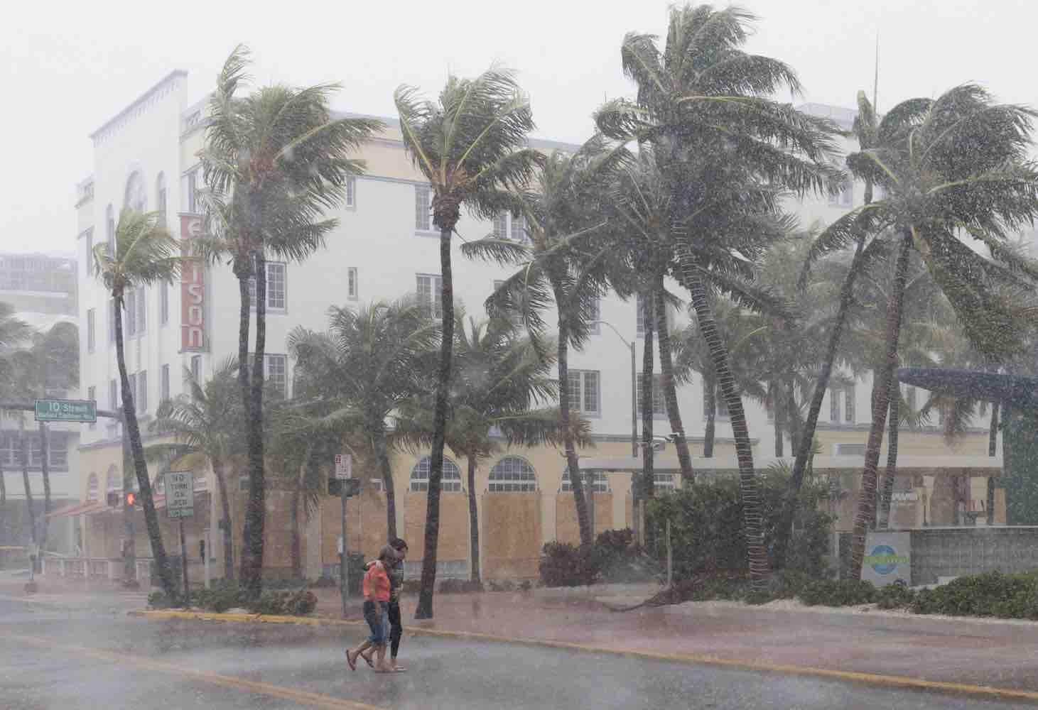 "<div class=""meta image-caption""><div class=""origin-logo origin-image kgo""><span>kgo</span></div><span class=""caption-text"">People walk down the street as winds and rain begin to hit as outer bands of Hurricane Irma arrive in Miami Beach, Florida, September 9, 2017. (SAUL LOEB/AFP/Getty)</span></div>"