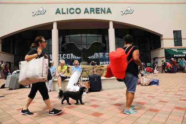 "<div class=""meta image-caption""><div class=""origin-logo origin-image kgo""><span>kgo</span></div><span class=""caption-text"">People arrive, many with their animals, a shelter at Alico Arena where thousands of Floridians are hoping to ride out Hurricane Irma on September 9, 2017 in Fort Myers, Florida. (Spencer Platt/Getty)</span></div>"