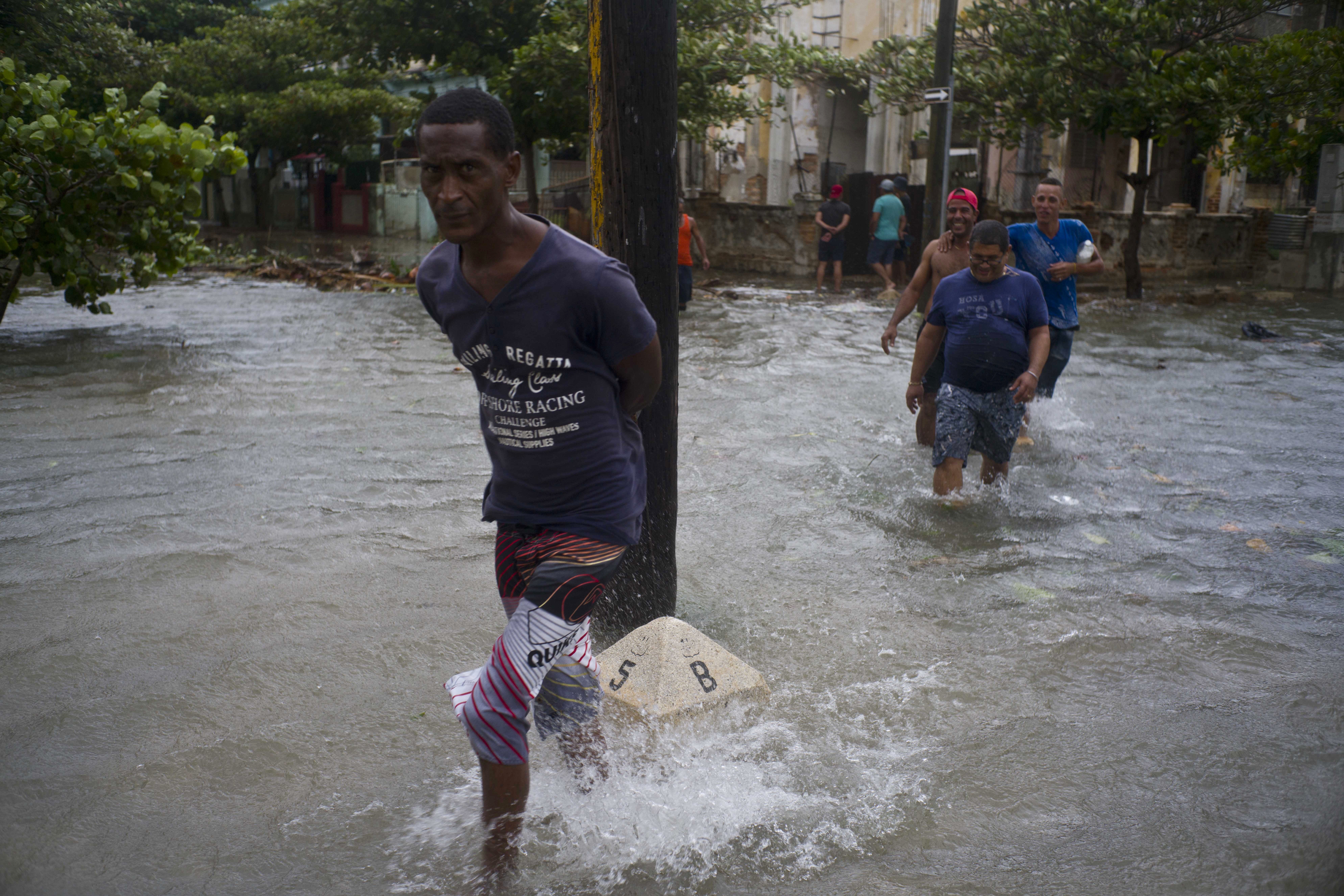 "<div class=""meta image-caption""><div class=""origin-logo origin-image none""><span>none</span></div><span class=""caption-text"">Men wade through a flooded street, caused by the passing of Hurricane Irma in Havana, Cuba, early evening Saturday, Sept. 9, 2017. (Ramon Espinosa/AP Photo)</span></div>"