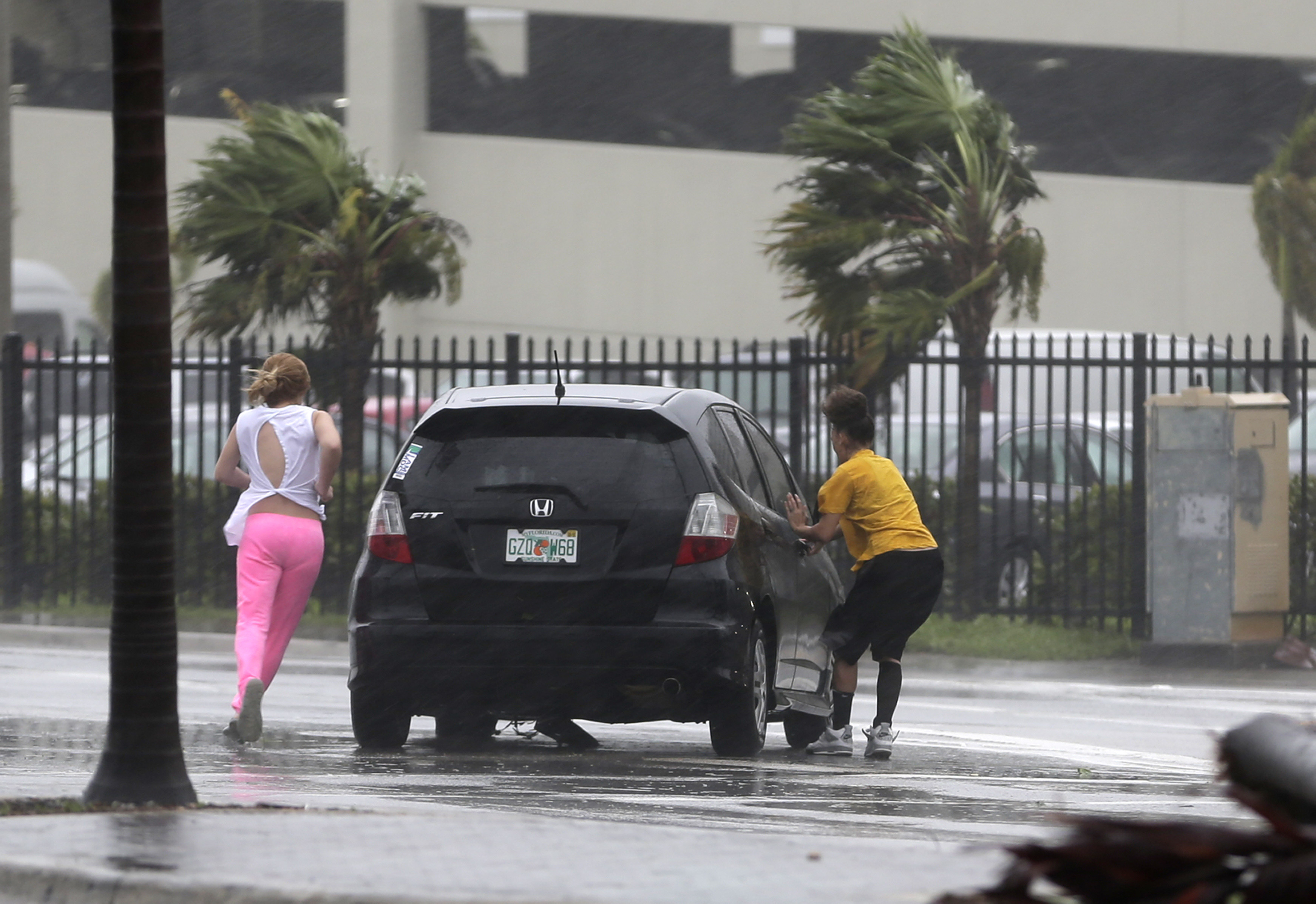 <div class='meta'><div class='origin-logo' data-origin='none'></div><span class='caption-text' data-credit='Alan Diaz/AP Photo'>Stranded motorists try to get back in their car after a breakdown as Hurricane Irma bears down on the Florida Keys, Sunday, Sept. 10, 2017, in Hialeah, Fla.</span></div>