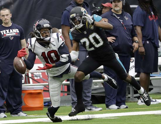 "<div class=""meta image-caption""><div class=""origin-logo origin-image ap""><span>AP</span></div><span class=""caption-text"">Jacksonville Jaguars cornerback Jalen Ramsey (20) breaks up a pass intended for Houston Texans wide receiver DeAndre Hopkins (10) during the second half. (David J. Phillip)</span></div>"
