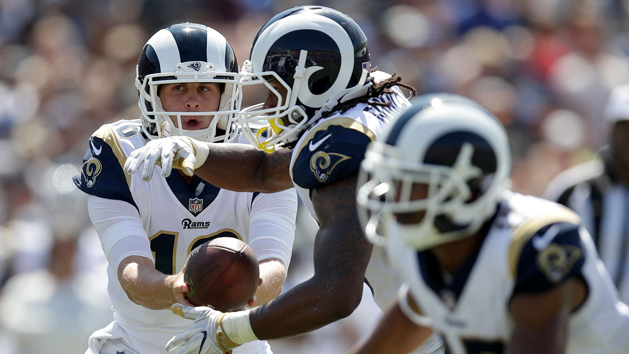Rams quarterback Jared Goff, left, hands off to running back Todd Gurley during LA's 46-9 win over the Indianapolis Colts on Sunday, Sept. 10, 2017 at the Coliseum.