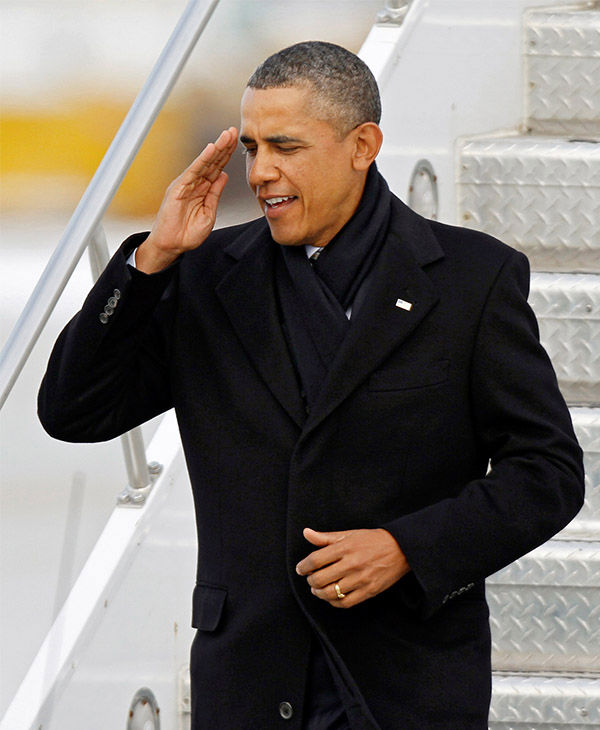 """<div class=""""meta image-caption""""><div class=""""origin-logo origin-image none""""><span>none</span></div><span class=""""caption-text"""">The president gives a salute while exiting Air Force One in January 2012. (Mark Duncan / AP)</span></div>"""