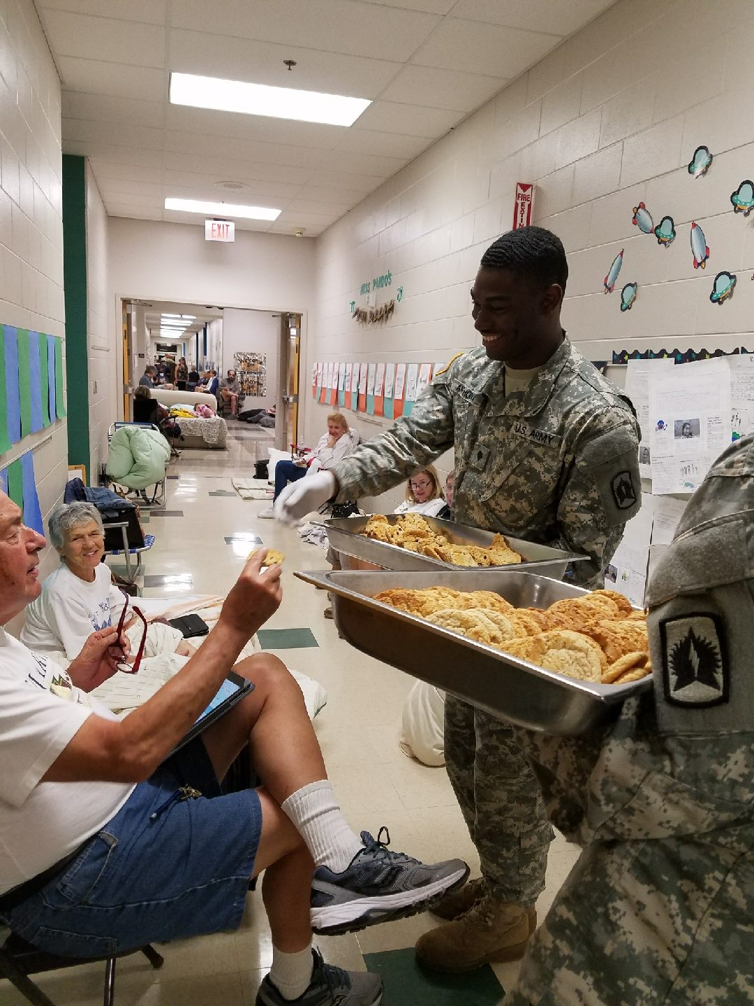 <div class='meta'><div class='origin-logo' data-origin='none'></div><span class='caption-text' data-credit='FLGuard/Twitter'>A National Guard soldier sang ''Happy Birthday'' to Shelby Johnson, 80, while passing out cookies.</span></div>