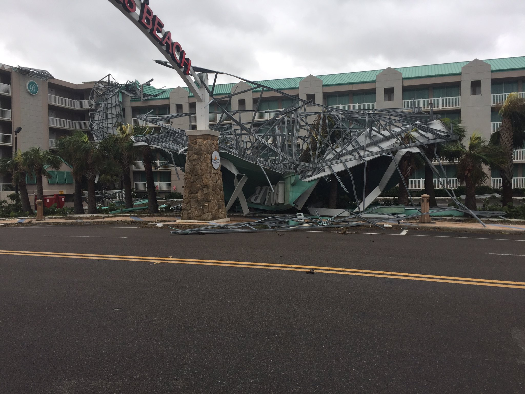<div class='meta'><div class='origin-logo' data-origin='none'></div><span class='caption-text' data-credit='Ty Russell/Daytona Beach'>Damage is shown near the ''World's Most Famous Beach'' sign in Daytona Beach on Monday.</span></div>