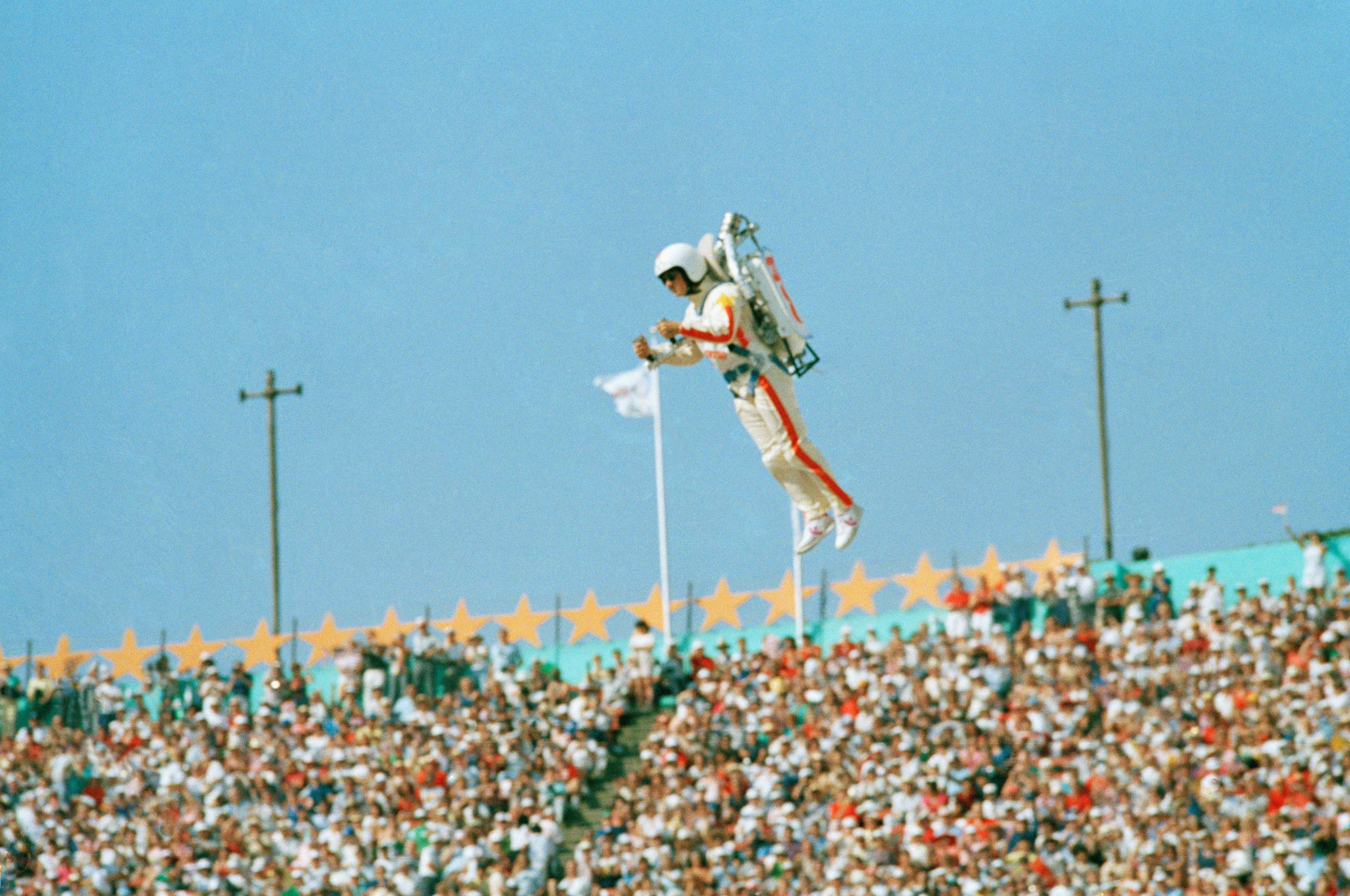 "<div class=""meta image-caption""><div class=""origin-logo origin-image ap""><span>AP</span></div><span class=""caption-text"">In this July 28, 1984 file photo Bill Suiter ""Rocket Man"" soars with the help of a jet pack during the welcoming of nations at the Opening ceremonies in the L.A. Memorial Coliseum. (AP Photo/Rusty Kennedy, file)</span></div>"