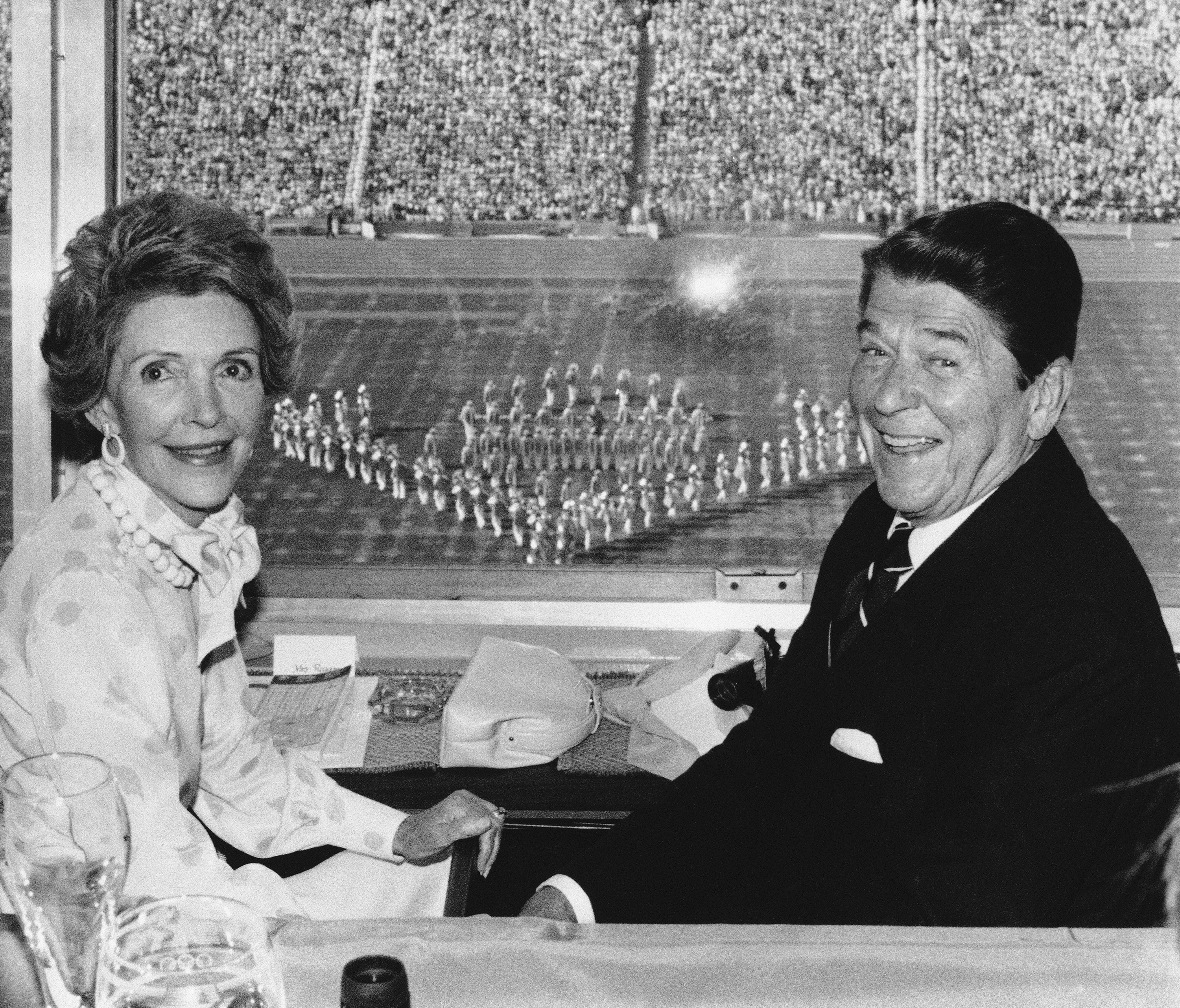"<div class=""meta image-caption""><div class=""origin-logo origin-image ap""><span>AP</span></div><span class=""caption-text"">In this July 28, 1984 photo President Ronald Reagan and first lady Nancy Reagan enjoy the Opening Ceremonies of the 23rd Olympiad from their press box view in the Coliseum. (AP Photo)</span></div>"