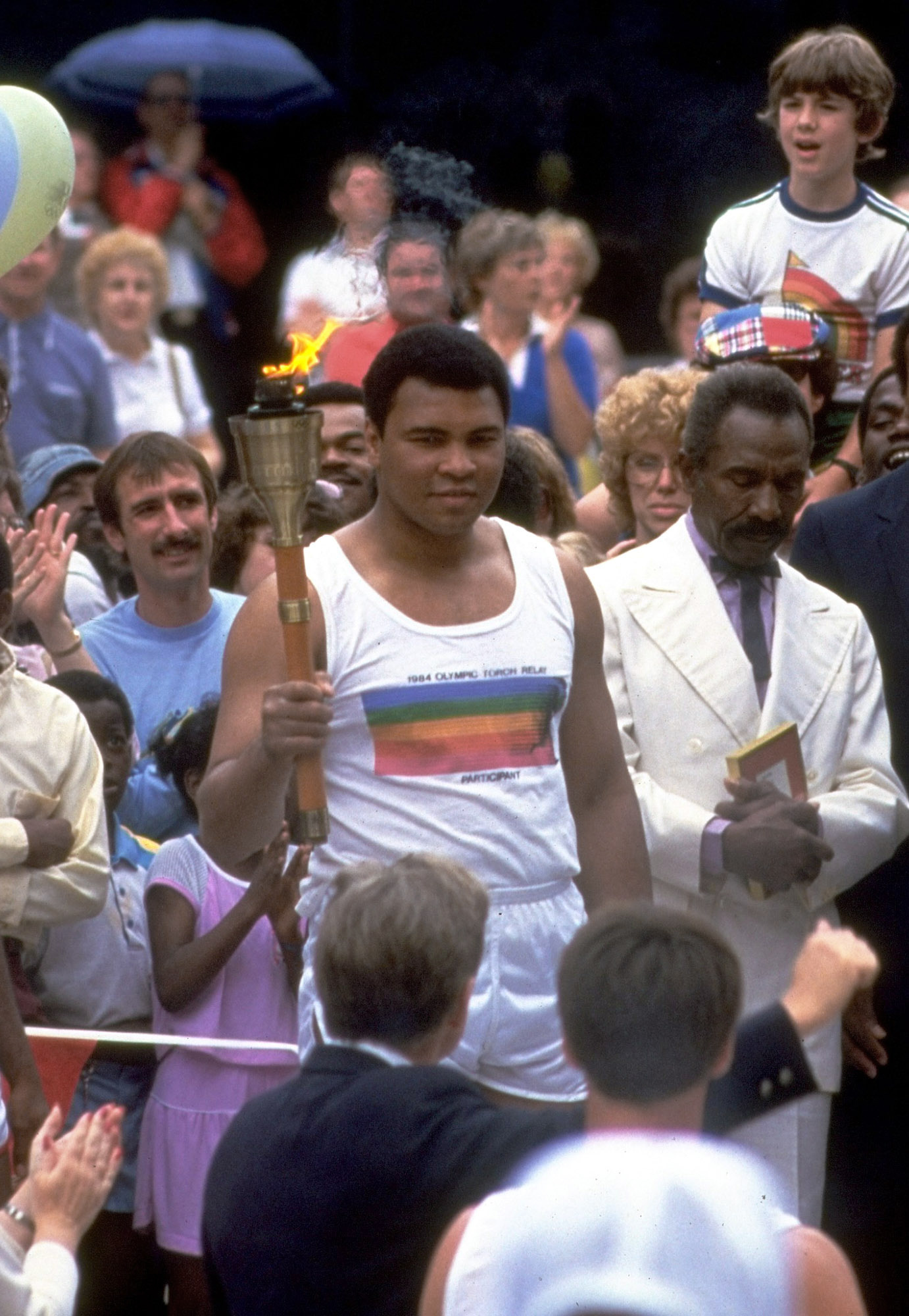 "<div class=""meta image-caption""><div class=""origin-logo origin-image ap""><span>AP</span></div><span class=""caption-text"">In this July 1984 file photo, former heavyweight champion Muhammad Ali carries the Olympic torch into the stadium in Los Angeles. (AP Photo/File)</span></div>"