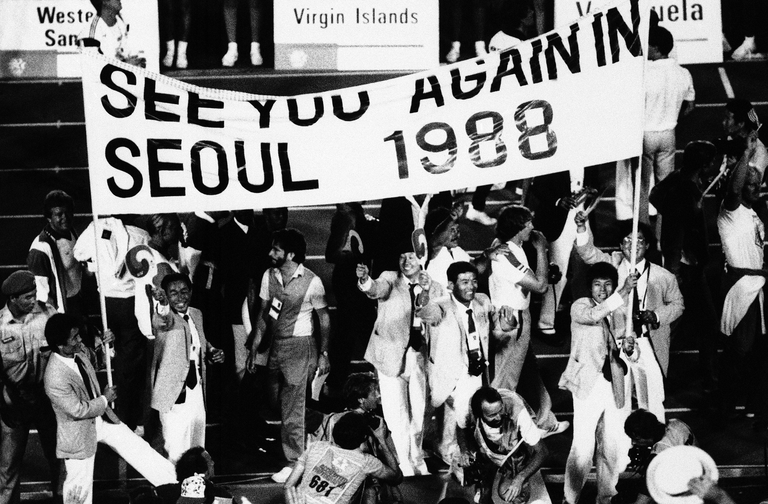 "<div class=""meta image-caption""><div class=""origin-logo origin-image ap""><span>AP</span></div><span class=""caption-text"">South Korean athletes hold a banner during the closing ceremonies of the XXIII Olympiad at the Coliseum in Los Angeles, Aug. 12, 1984. (AP Photo/Lionel Cironneau)</span></div>"
