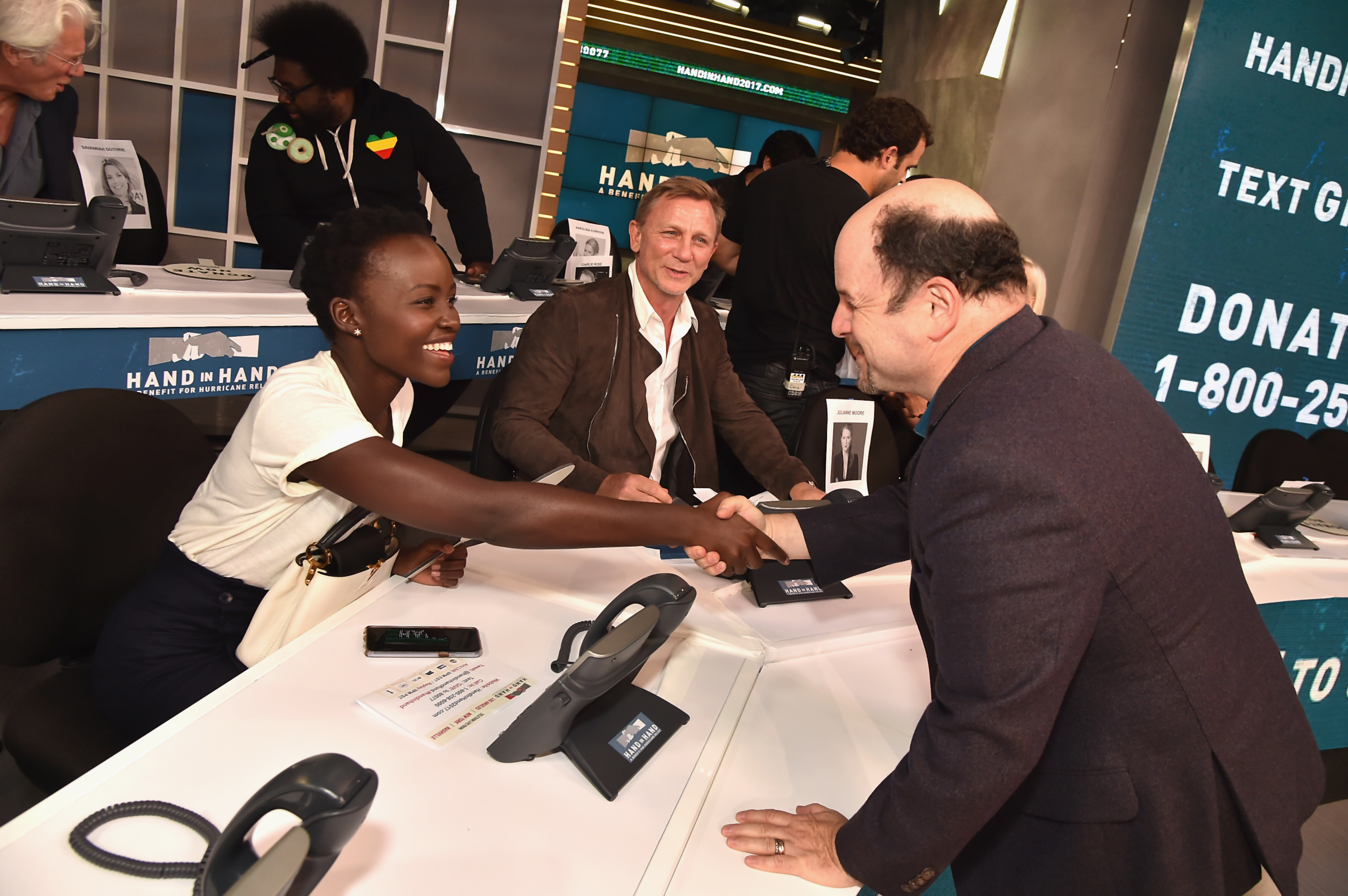 """<div class=""""meta image-caption""""><div class=""""origin-logo origin-image none""""><span>none</span></div><span class=""""caption-text"""">Lupita Nyong'o, Daniel Craig and Jason Alexander  attend the Hand in Hand benefit at ABC News' Good Morning America Times Square Studio on Sept. 12 in New York City. (Theo Wargo/Hand in Hand/Getty Images)</span></div>"""