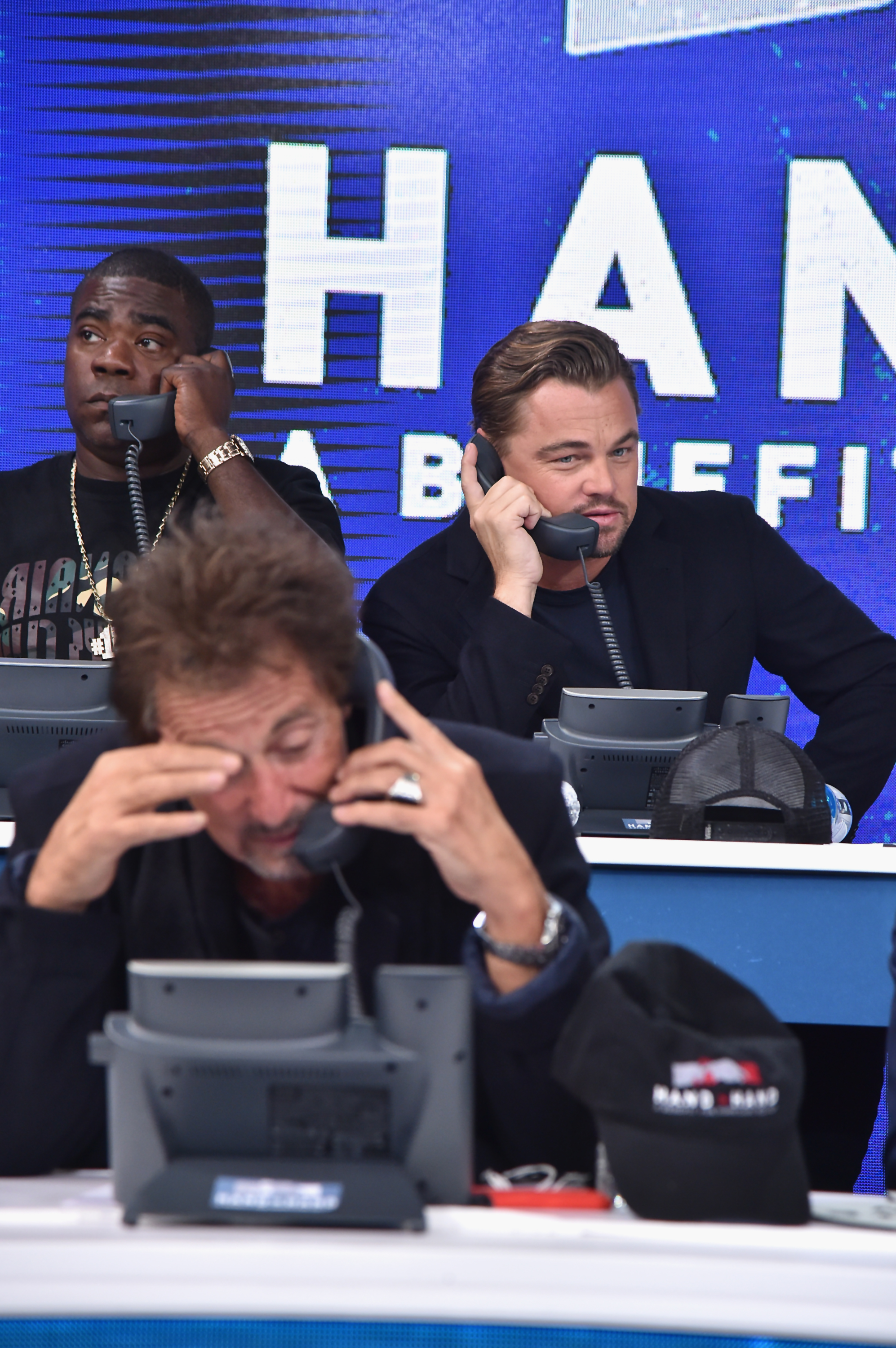 "<div class=""meta image-caption""><div class=""origin-logo origin-image none""><span>none</span></div><span class=""caption-text"">Tracy Morgan, Leonardo DiCaprio and Al Pacino man the phones during the Hand in Hand benefit at ABC News' Good Morning America Times Square Studio in New York. (Theo Wargo/Hand in Hand/Getty Images))</span></div>"