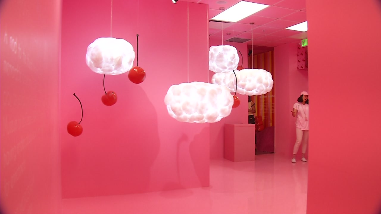 Cherries and whipped cream dangle from the ceiling in a display at the Museum of Ice Cream San Francisco on Thursday, Sept. 14, 2017.