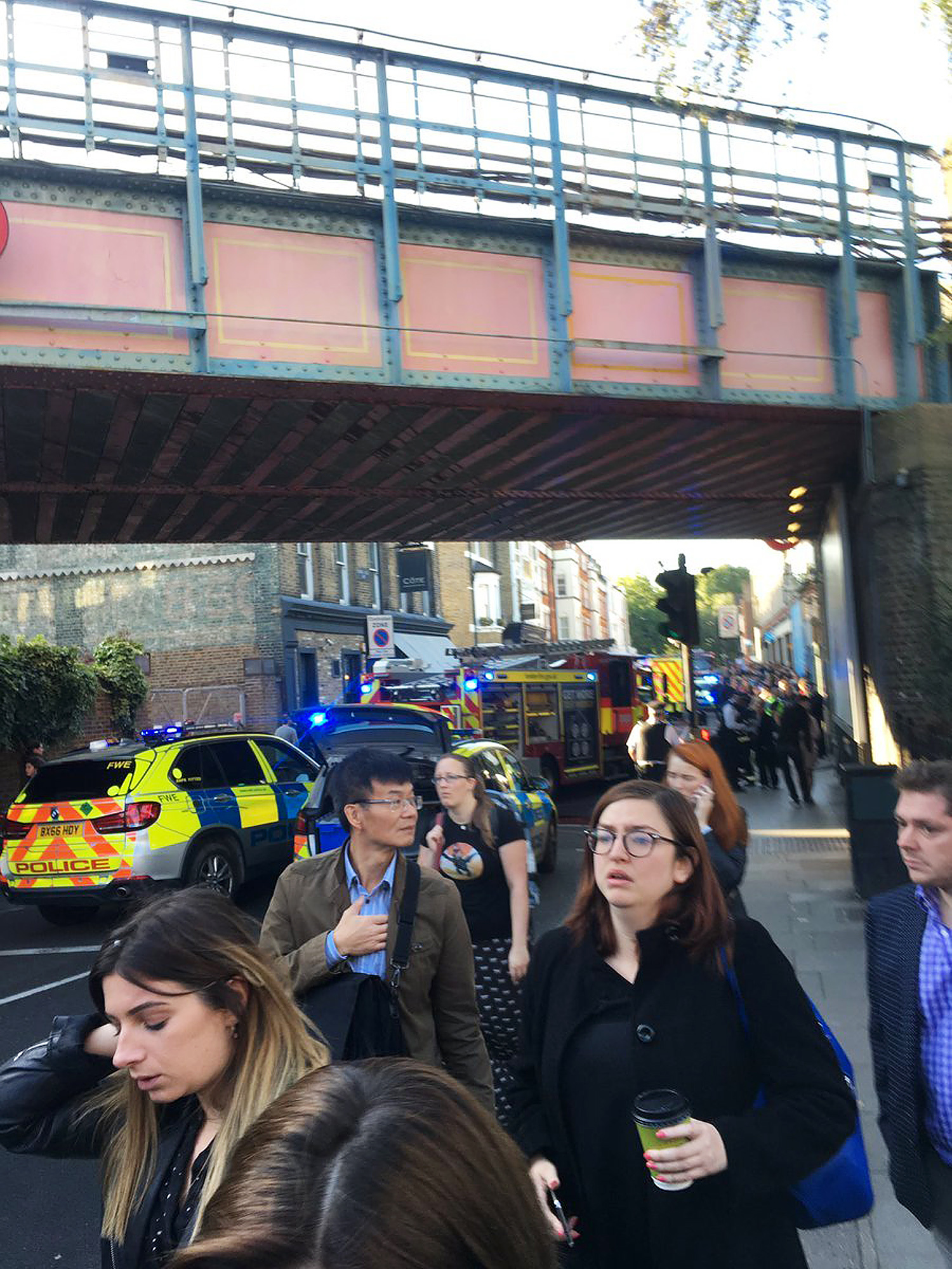 <div class='meta'><div class='origin-logo' data-origin='none'></div><span class='caption-text' data-credit='Alex Littlefield via AP'>People leave the scene of an explosion at a southwest London subway station in London Friday, Sept. 15, 2017.</span></div>
