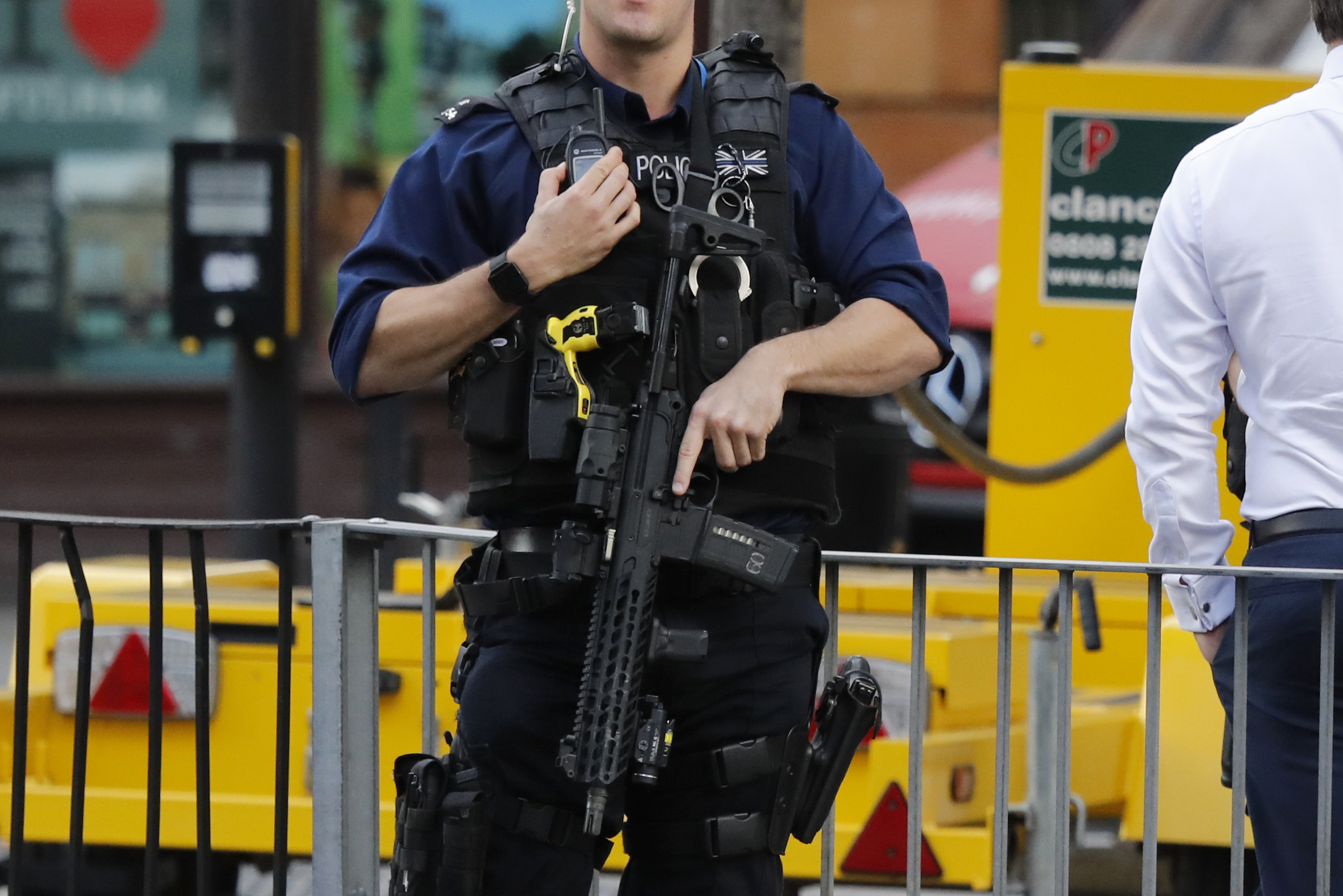 <div class='meta'><div class='origin-logo' data-origin='none'></div><span class='caption-text' data-credit='Frank Augstein/AP Photo'>An armed police officer stands nearby after an incident on a tube train at Parsons Green subway station in London, Friday, Sept. 15, 2017.</span></div>
