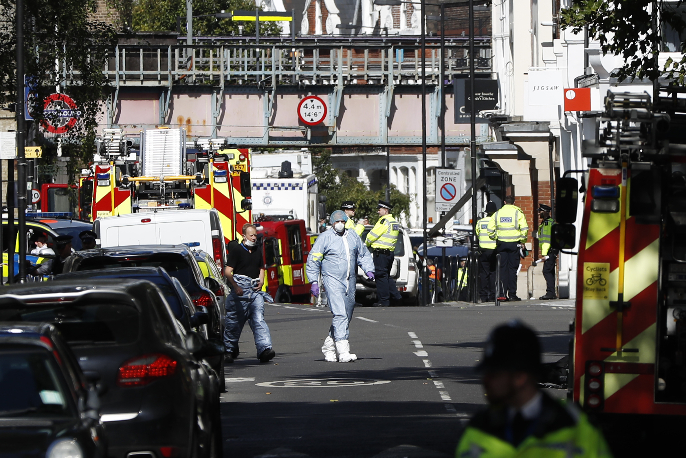 <div class='meta'><div class='origin-logo' data-origin='none'></div><span class='caption-text' data-credit='Kirsty Wigglesworth/AP Photo'>Police forensic officers walk within a cordon near where an incident happened, that police say they are investigating as a terrorist attack, at Parsons Green subway station.</span></div>