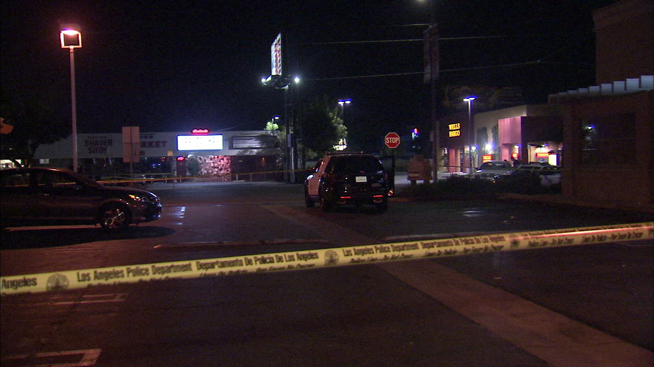 Crime tape surrounds the scene of a deadly shooting in Van Nuys late Sunday, Sept. 10, 2017.