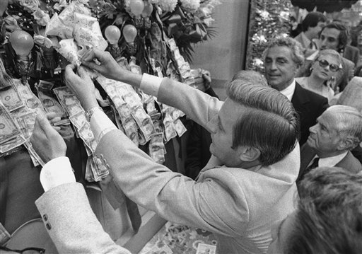 "<div class=""meta image-caption""><div class=""origin-logo origin-image ap""><span>AP</span></div><span class=""caption-text"">Democratic vice presidential candidate Walter Mondale pins money on the base of the statue of San Gennaro, Sunday, Sept. 19, 1976 (Associated Press)</span></div>"