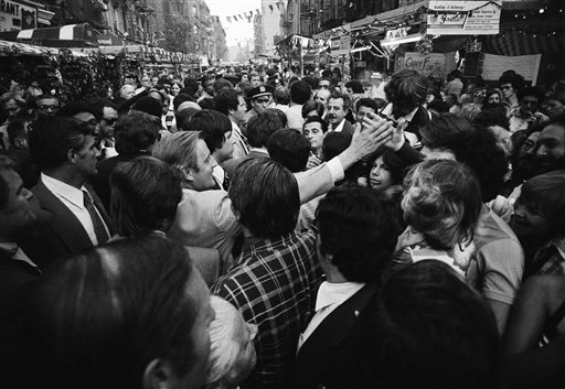 "<div class=""meta image-caption""><div class=""origin-logo origin-image ap""><span>AP</span></div><span class=""caption-text"">Sen. Walter Mondale, democratic vice presidential candidate, reaches cut to shake hands as he is engulfed in crowd at the San Gennaro festival in Little Italy Sept. 19, 1976. (Associated Press)</span></div>"