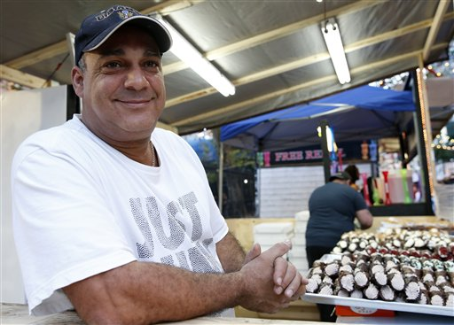 "<div class=""meta image-caption""><div class=""origin-logo origin-image ap""><span>AP</span></div><span class=""caption-text"">Robert Diaz poses with a variety of cannoli while working for a vendor at the Feast of San Gennaro on Mulberry Street in New York's Little Italy neighborhood, Sept. 15, 2016 (AP Photo/Kathy Willens))</span></div>"
