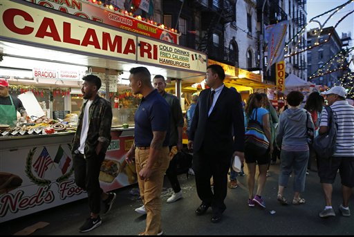"<div class=""meta image-caption""><div class=""origin-logo origin-image ap""><span>AP</span></div><span class=""caption-text"">People stroll down checking out the offerings from food vendors Mulberry Street during the annual Feast of San Gennaro in New York's Little Italy neighborhood, Sept. 15, 2016 (AP)</span></div>"