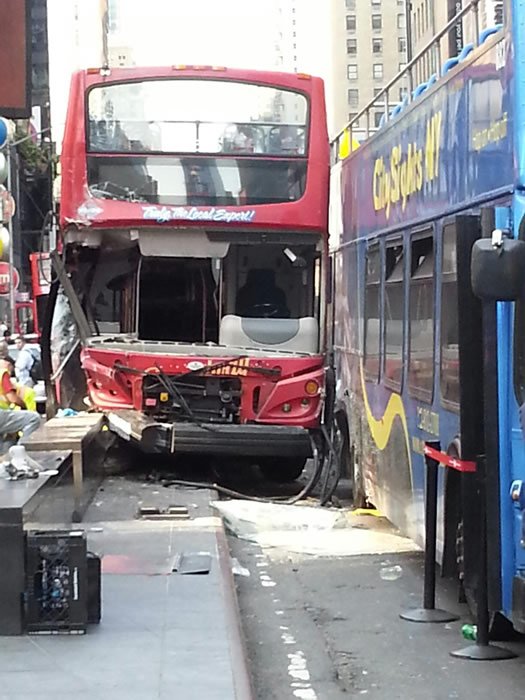 "<div class=""meta image-caption""><div class=""origin-logo origin-image ""><span></span></div><span class=""caption-text"">Two double-decker buses crashed in New York's Time Square. (Photo courtesy Sirena)</span></div>"