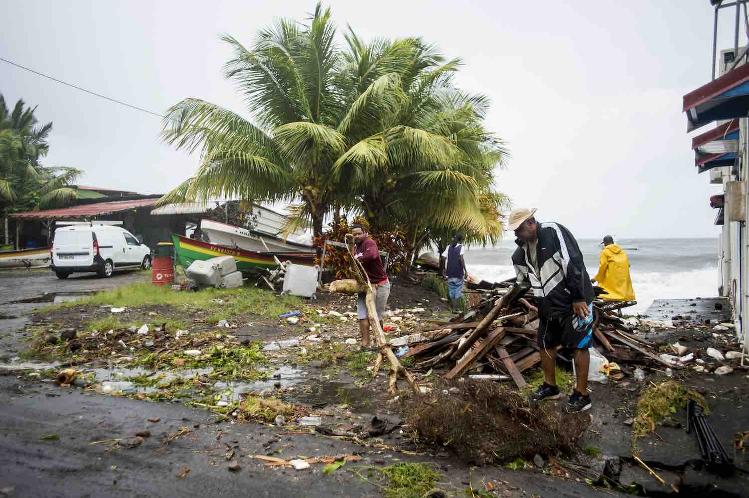 <div class='meta'><div class='origin-logo' data-origin='Creative Content'></div><span class='caption-text' data-credit='LIONEL CHAMOISEAU/AFP/Getty'>People clear debris in Saint-Pierre, on the French Caribbean island of Martinique, after it was hit by Hurricane Maria, on September 19, 2017.</span></div>